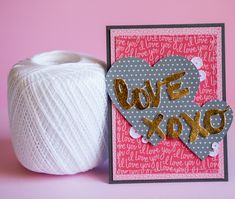 Love xoxo - Scrapbook.com - Mix digital and manual die cutting and machine stitching on a handmade valentine's day card.