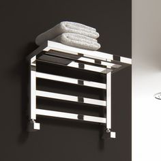 Make use of all the space in your bathroom with this wall mounted towel warmer & shelf. It's a gorgeous way to display your towels too for a hotel bathroom look you'll love.