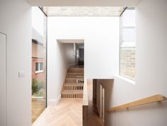 The bespoke staircase in Step House by Grey Griffiths Architects allows light to pass from the original end-of-terrace workers' cottage into an extension. Staircase Handrail, New Staircase, Minimal Home, Minimalist Home Decor, Architecture Details, Interior Architecture, Interior Design, Bespoke Staircases, Narrow Lot House Plans