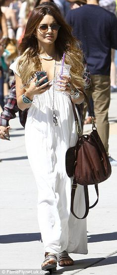 Signature style: The Spring Breakers star Vanessa Hudgens completed her hippy chick look with a pair of stylish round sunglasses, a long pendant and numerous cuff bracelets, while toting a slouchy chocolate brown leather shoulder bag