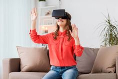 happy woman in virtual reality headset at home by dolgachov. technology, augmented reality, gaming, entertainment and people concept – young man with virtual headset or glasse. Virtual Reality Headset, Augmented Reality, Cool Backdrops, Wellness Industry, Flatlay Styling, Wearable Device, Happy Women, Software Development, How To Relieve Stress