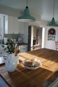wood countertops, mint hanging lights & penny tile backsplash, white ikea cabinets, gray walls, aqua ceiling | diy squirrel