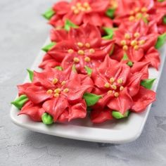 Christmas Poinsettia Meringue Cookies - these are GORGEOUS. Color meringue batter, scoop it into icing bags, and you could make a million different designs. Christmas Poinsettia, Christmas Sweets, Christmas Cooking, Christmas Goodies, Christmas Candy, Diy Christmas, Xmas, Holiday Treats, Holiday Recipes