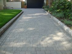 I like the grey brick for the front - This project consisted of installing a new driveway using a Marshalls product known as Marshalls Drivesett Tegula. The colour of the block paving is pennant grey. Front Garden Ideas Driveway, Modern Driveway, Driveway Landscaping, Modern Landscaping, Block Paving Driveway, Brick Driveway, Driveway Entrance, Driveway Border, Cobblestone Driveway