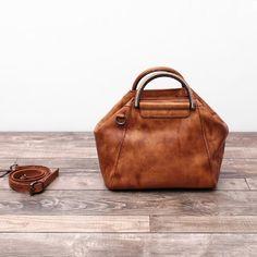 Leather Messenger Bag Women Shoulder Bag Satchel Bag  We use genuine cow leather, quality hardware and fabric to make the bag as good as it is.  •Comfortable Shoulder Strap. • Inside zipper pocket, cell pocket •Ancient black gold hardware  •Length: 26cm; Height: 21cm;Width: 17cm •Color:Brown/Purple/Blue/Red/Grey