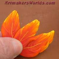 Hot flaming orange polymer clay feather cane