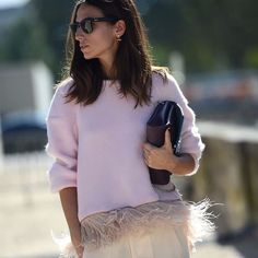 On the Streets of Paris Fashion Week: pink sweater with feather trim