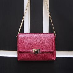 Invest in a super-cute party accessory with this pink croc effect clutch with a flip lock and gold chain. #Topshop