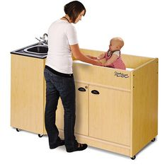 Hot Water Portable Sink Diaper Changer w/Integrated ABS Top and Basin from Honor Roll Childcare Supply.