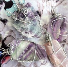 Wire wrapped fluorite crystal pendants.