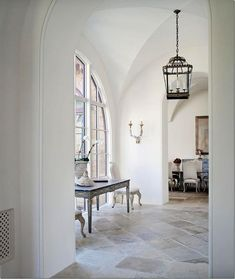 A beautiful Tuscan inspired home by architect, Kevin Harris. Love the floors, arches and soaring ceilings … and those enormous lanterns inside & out. kitchen with antique stone flooring … beautiful outdoor area … what a view! Design Entrée, Floor Design, House Design, Foyer Flooring, Stone Flooring, Flooring Ideas, Interior Exterior, Interior Design, Entry Hallway
