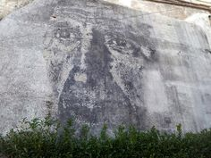 Internationally-known Portuguese street artist Vhils created this work of art on a bare wall in the central Portugal city of Covilhã.  A group known as WoolFest commissions many public art works around the city.