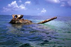 An American tank from the World War II battle remained stranded on Invasion Beach in Saipan in April of 2000.