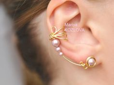 Ear cuffs, my new obsession...Gold and Powder Rose Color Dragonfly Wings Cuff Earrings - Genuine Swarovski Pearls, tarnish resistant wire. $15.65, via Etsy.