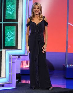 LM COLLECTION: Midnight blue jersey gown w/shoulder straps w/drop sleeves, v-neckline and CF enhanced in red rhinestones, vertical cascade down CF | Vanna White's dresses | Wheel of Fortune