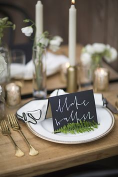 Black place cards with white calligraphy | Everest Road Photography | see more on: http://burnettsboards.com/2014/05/style-bistro-wedding-reception/