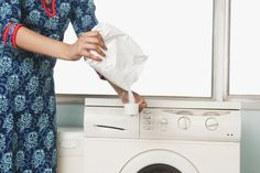 Before you start to notice an odor in your appliance, disinfect it with distilled white vinegar and baking soda. Run the machine with hot water, add the cleaning agents (for top-loading machines, 3 to 4 cups of vinegar to ½ cup of baking soda; for front loading, 1/4 cup of vinegar to 4 tablespoons of baking soda), and let sit for 30 to 60 minutes after running. Restart the machine, let the water drain, wipe down, and air dry.