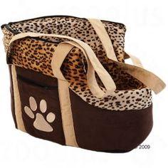Trasportino con maniglia, bordo leopardato e piedi d'appoggio. Ideale per il trasporto di piccoli cani.