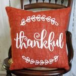 Made from a burnt orange colored burlap fabric. Hand-stenciled in white or the color of your choice. Lined in muslin with a muslin backing. Size 14 x 14