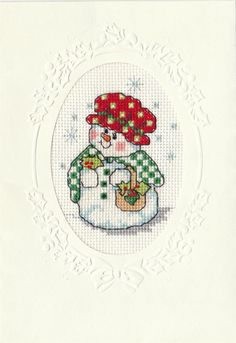 Here's the one I stitched. I think she is adorable :-)