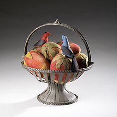 """Basket of Strawberries.  A tenth anniversary tin basket is filled to the brim with velvet strawberries. The compote itself, is constructed from one round of tin; 13 ½""""H, 12""""W. There are five large strawberries, one medium, and one very rare small one, topped with two Lancaster County fabric birds. Excellent condition and color."""