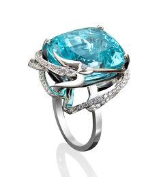 Paraiba tourmaline and diamond ring from Boodles, featuring an important cushion cut Paraiba tourmaline of 21.63ct, set in a diamond set swirling bird design.