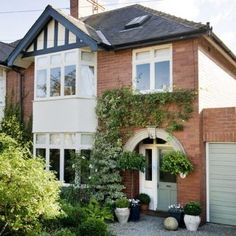 Exterior traditional house tour house photo gallery beautiful homes housetohome. Style At Home, Exterior Paint, Exterior Design, Garage Exterior, Garage Design, 1930s House Exterior Uk, Garage Doors Uk, Black Exterior, 1930s Semi Detached House
