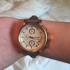 never worn Fossil leather band watch dark green/brown color band with gold/bronze colored accents :) white face. never worn. super cute just never wear. Fossil Accessories Watches