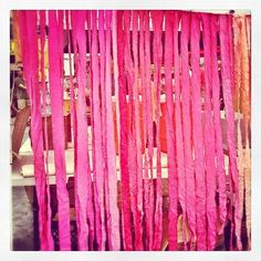 Ombré dyed sheet cut/ripped into strips to make a pretty fabric backdrop for a food stand at #brooklynflea in #williamsburg. Could work for a photo booth backdrop, behind a dessert table, or altar backdrop.