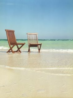 Relaxation! Pair of Wooden Lounge Chairs on Beach.