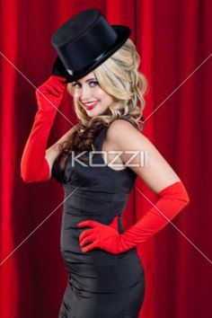gorgeous woman  smiling - Image of Gorgeous woman smiling with red black hat and dress, red gloves, red lips