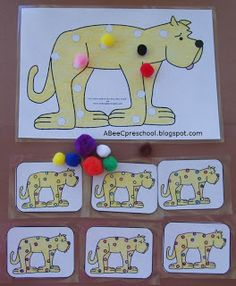 """Put Me in the Zoo""  by Robert Lopshire.  The children will choose a card, and using pom poms, duplicate the colored spots shown on the small card on the large card.  This practices visual discrimination which helps with early reading skills.  For the younger children it will also help with color recognition."