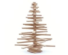 Looking for an alternative Christmas tree this year? One Two Tree is an eco-friendly Christmas tree that consists of 26 'branches' that rotate on a 'trunk'. Wooden Christmas Tree Decorations, Tabletop Christmas Tree, Christmas Tree Design, Mini Christmas Tree, Holiday Tree, Ikea Christmas, Pallet Christmas, Xmas Trees, Green Christmas