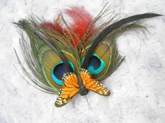 Peacock Feather Butterfly Hair Clip. $15.00, via Etsy.