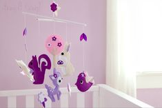 lOVE  This adorable #woodland mobile fits in perfectly in this #purple #nursery