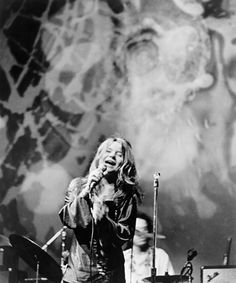 Janis Joplin with Big Brother & the Holding Co.  Janis Joplin performs with Big Brother & the Holding Company, circa 1968. photo Michael Ochs