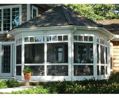 What a great screened porch. I was raised with a Grandmother who had a pourch much like this, we used to sleep on the porch in the summer. S.W