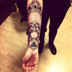 mandala tattoo with armor-like border