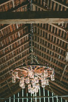 DIY wheel and mason jar chandelier //  Carly Short Photography // http://www.theknot.com/submit-your-wedding/photo/fa0f6fc1-89dd-4c49-95f2-95877ed7d76b/Canyon-Run-Ranch