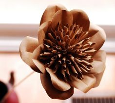 How to make beautiful paper flowers out of Kraft paper card stock.