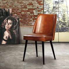 Garbo chair by Oliver B Buffalo leather and black wooden legs