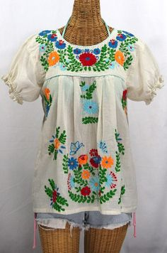 "Such a classic look!  The ""La Mariposa Corta de Color"" Embroidered Mexican Peasant Blouse in Off White with Fiesta Embroidery for Summer."