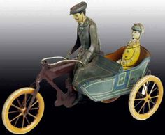 Wilhelm Krauss - Motorcycle & Sidecar with Rider & Passenger. Painted Tinplate with Clockwork Mechanism. Germany. Circa 1910.