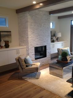 Pravada Engineered Hardwood (Haute Couleur, Brule) and Quartz Ledgestone Fireplace. Supplied and Installed by Floor Trendz.