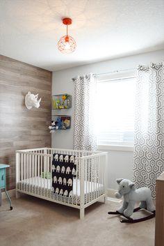 hank's room tour featuring maple laminate wood wall and DIY plumbing pipe curtain rod. #MyUrbanBarn