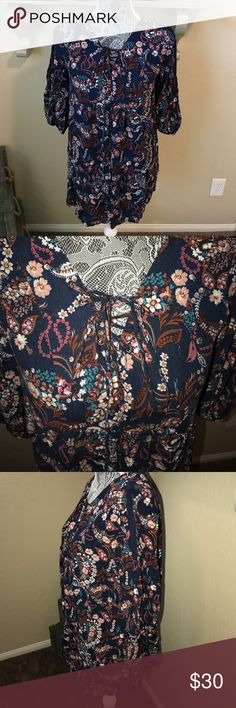 New Ro & De front lace tunic Gorgeous tunic.  Navy background with mauve, turquoise, rust, cream and light pink floral paisley print. Never worn and from a smoke free home!  New but no tags☹️ Ro & De Tops Tunics