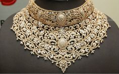 Dazzling bridal diamond necklace sets studded with diamonds and emeralds