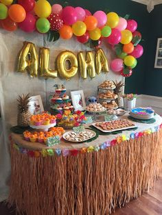 Lilo and Stitch Luau Birthday Party. Balloon Garland backdrop. food table