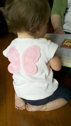 Baby girls and butterfly wings via Flickr. My granddaughter (look at the sweet toes)!