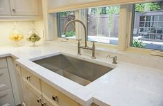 cabria quartz countertops, cearmy white cabinetry